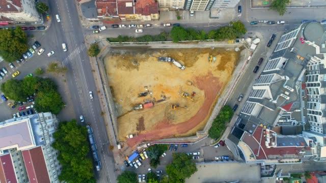 aerial eagle eye ascending shot of city construction site in business district sofia, bulgaria - bułgaria filmów i materiałów b-roll