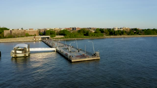 Aerial Establishing Shot of Pier next to an Urban Neighborhood (Bay Ridge, Brooklyn, New York)