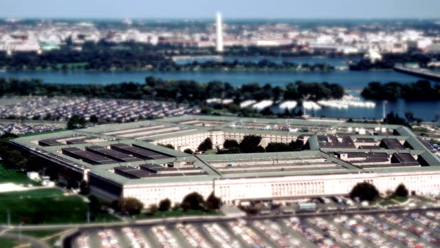 Aerial establishing shot of the Pentagon building Aerial establishing shot of the Pentagon building with a small amount of traffic in front. 4K UHD. us military stock videos & royalty-free footage