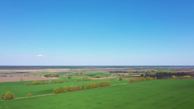 Aerial Europe Valley Farming crops agricultural arable farmland vegetation water field industry investment nature, early spring. video