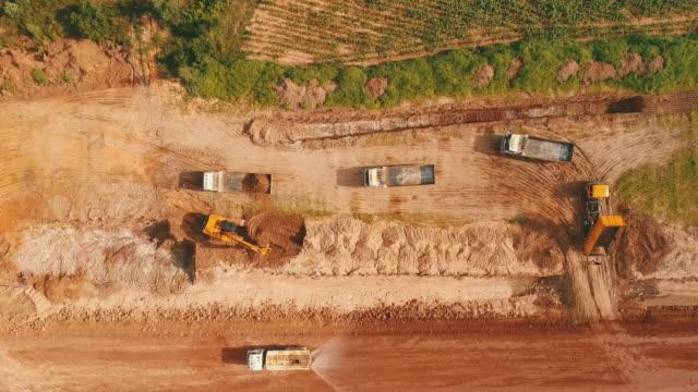 aerial grävmaskin arbetar - excavator bildbanksvideor och videomaterial från bakom kulisserna