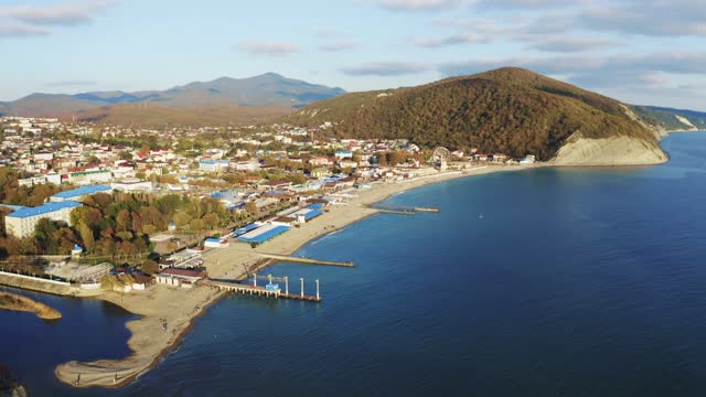 Aerial flight on drone above sea resort coastline with blue sea water and mountains with small town video