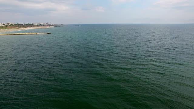 Aerial flight over Constanta beach, Black Sea, Romania Aerial flight over Constanta beach, Black Sea, Romania arthropod stock videos & royalty-free footage