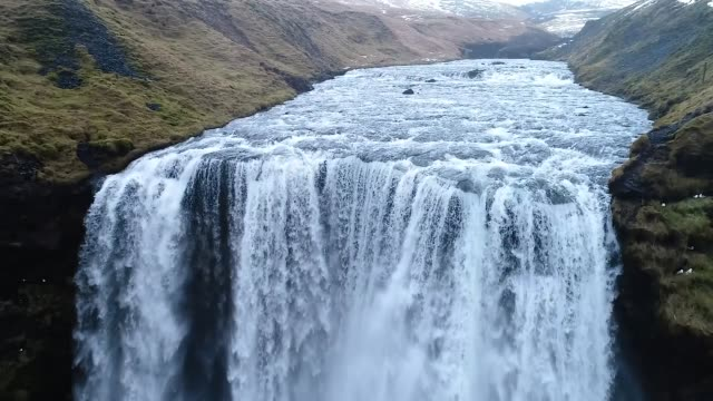 Video Aerial flight with drone over the famous Skogar waterfall , Iceland.