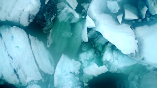 Aerial flight with drone over the of icebergs floating in Jokulsarlon Lagoon by the southern coast of Iceland Aerial flight with drone over the of icebergs floating in Jokulsarlon Lagoon by the southern coast of Iceland icecap stock videos & royalty-free footage