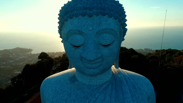 Aerial: Fly away from Big Buddha face. video