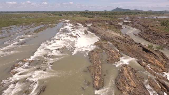 aerial :fly back over series of cascading waterfalls and rapids in the Mekong river aerial :fly back over series of cascading waterfalls and rapids in the Mekong river back to back stock videos & royalty-free footage