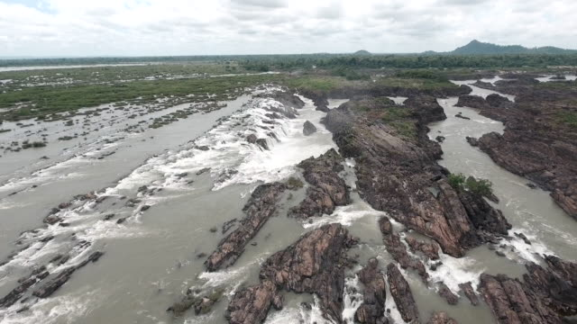 aerial : fly back over series of cascading waterfalls and rapids in the Mekong river aerial : fly back over series of cascading waterfalls and rapids in the Mekong river back to back stock videos & royalty-free footage