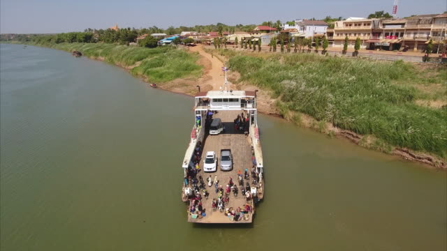 aerial : fly back revealing a ferry boat moored at the river's edge aerial drone shot : fly back revealing a ferry boat moored at the river's edge back to back stock videos & royalty-free footage