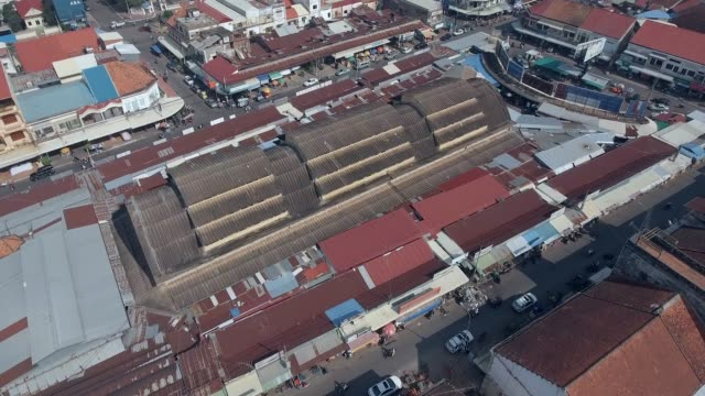 aerial: fly back revealing the french colonial market in the typical asia town aerial drone shot : fly back revealing the french colonial market in the typical asia town back to back stock videos & royalty-free footage