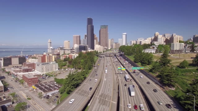 Aerial Flyback Over Interstate Freeway with Downtown Seattle Skyscraper Buildings video