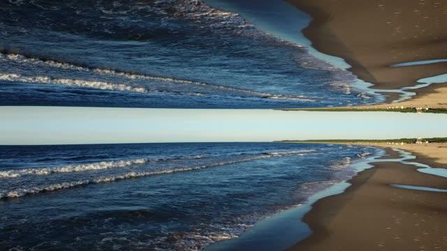 stockvideo's en b-roll-footage met lucht vliegen laag over zandstrand zee golven op baltische zee spiegel patroon - psychedelisch