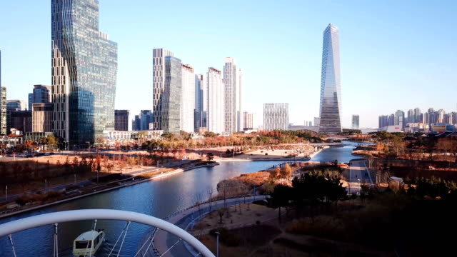 flyg flyga över inchon, central park i songdo international business district, sydkorea - seoul bildbanksvideor och videomaterial från bakom kulisserna