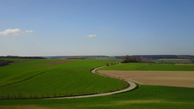 Aerial: flying over the agrarian hilly fields in Somme-Leuze in Belgian Ardennes video