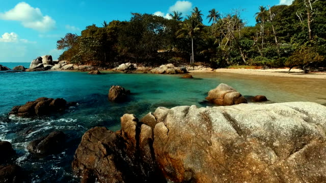 aerial: flying over water and rocks in the sea. - phuket video stock e b–roll