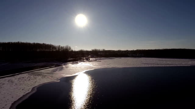 Aerial Flying over water in the winter