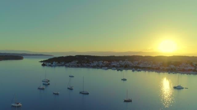 Aerial - flying sideways above a small harbor at dusk - Porto Heli - Porto Cheli - Greece - Argolis - Argolida video