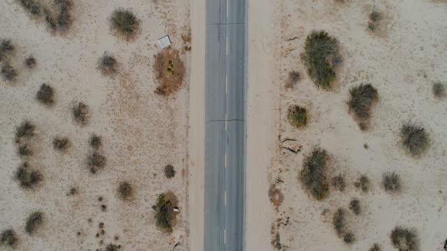 aerial flyover of desert road - nevada video stock e b–roll