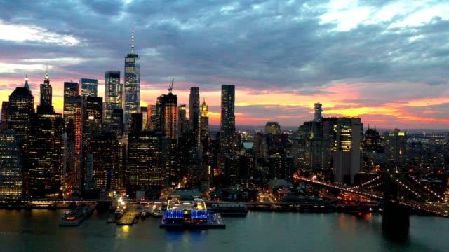 aerial flyover of new york skyline at night - skyline video stock e b–roll