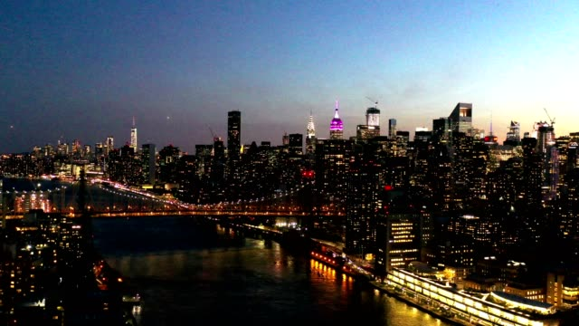 Aerial Flyover of New York Skyline at Night An aerial flight over the Manhattan skyline at night in New York. new york city skyline stock videos & royalty-free footage