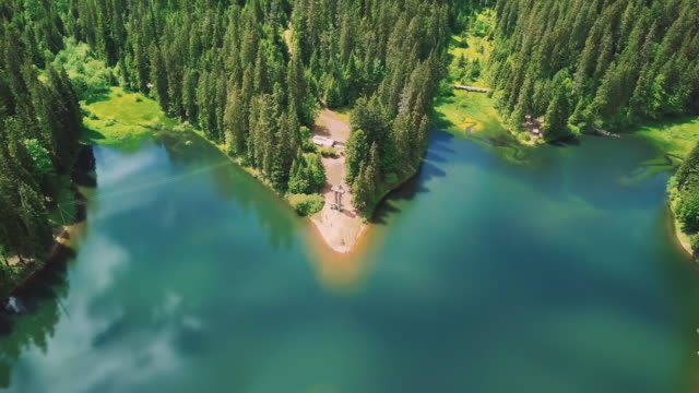 Aerial flythrough of beautiful lake and mountains 3 video