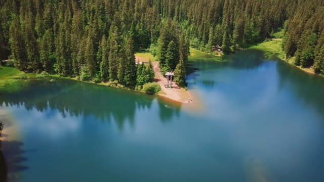 Aerial flythrough of beautiful lake and mountains video