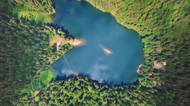 Aerial flythrough of beautiful mountains and forest and lake> Rotation View video