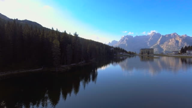 Aerial flythrough of beautiful reflection lake and mountains video