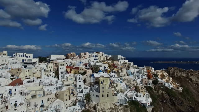 Aerial footage above white buildings on the island of Santorini. Greece video