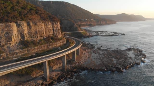 Aerial footage Australia coast landscape Sea Cliff Bridge NSW Australia video