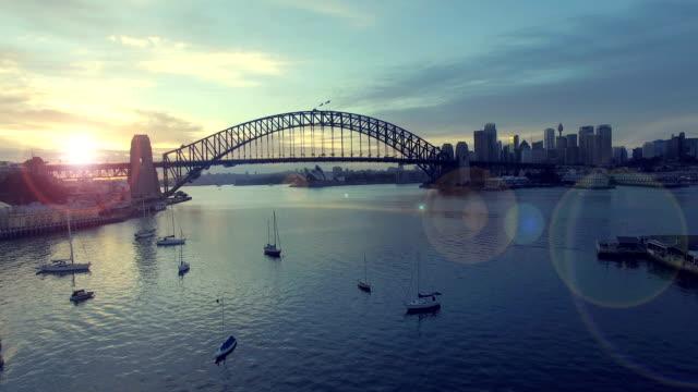 aerial footage b-roll of Sydney Harbour Bridge during sunrise.