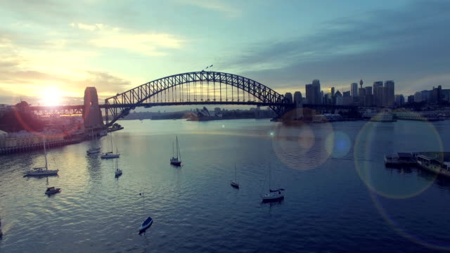 aerial footage b-roll of sydney harbour bridge during sunrise. - antena filmów i materiałów b-roll