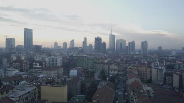aerial footage drone view sunrise milan skyline sunrise - milan video stock e b–roll