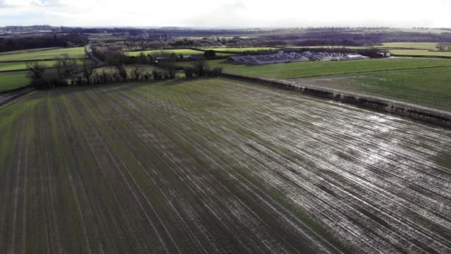 Aerial footage flying over a farmers field video