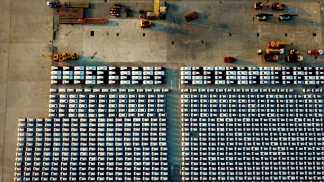 Aerial footage flying over new cars parked on an industrial storage platform Aerial footage flying over new cars parked on an industrial storage platform southeast stock videos & royalty-free footage