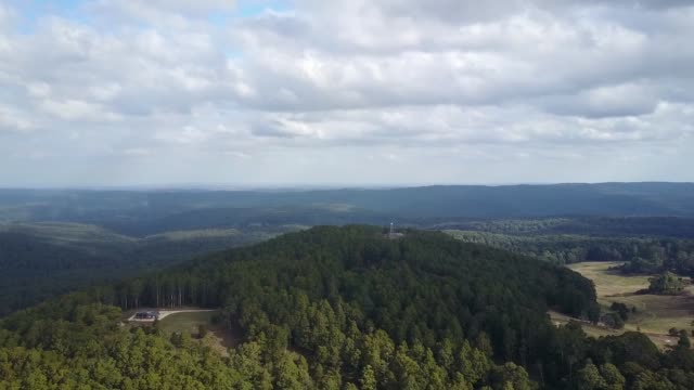 Aerial footage flying towards Blue Mountain with a fire tower, near Newbury, central Victoria, Australia.