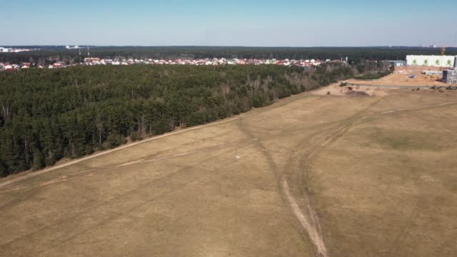 Aerial footage of a small model aircraft flying in the air.