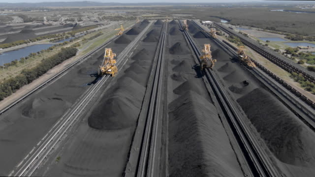 Aerial footage of coal stockpiles and bucket wheel excavators Aerial footage of coal stockpiles and bucket wheel excavators oceania stock videos & royalty-free footage