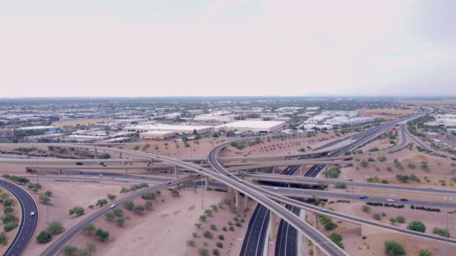 Aerial footage of Interstate 10 and 202 interchange at Chandler,Ahwatukee Foothills area of Phoenix, Arizona, USA