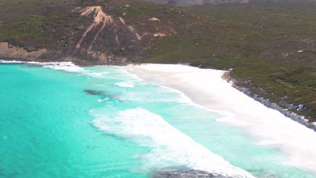 Aerial footage of Lucky bay in Esperance's Cape le Grande national park, camping sites visible on in the background. Australia.