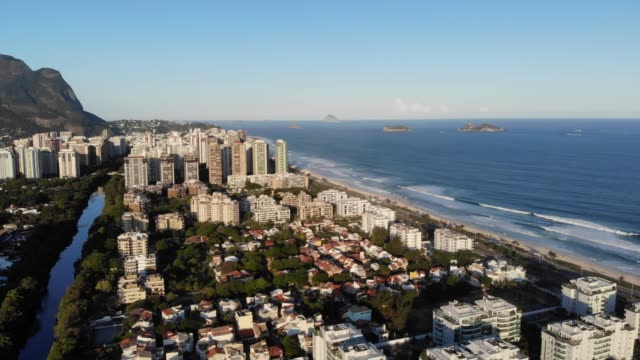 Aerial footage of Marapendi canal and Barra da Tijuca on a summer day, with the Gavea Stone in the background video