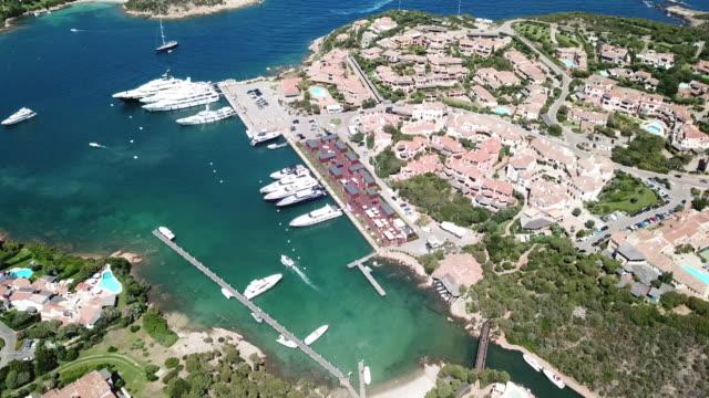 aerial footage of porto cervo, costa smeralda, sardinia, italy - sardegna video stock e b–roll