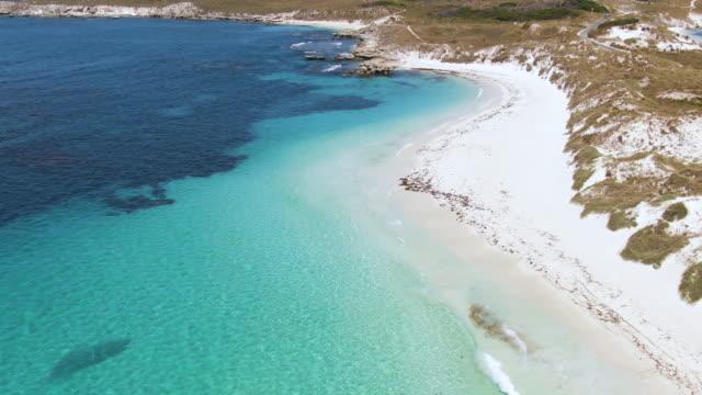 aerial footage of pristine rottnest island. western australia travel and tourism. - adulazione video stock e b–roll