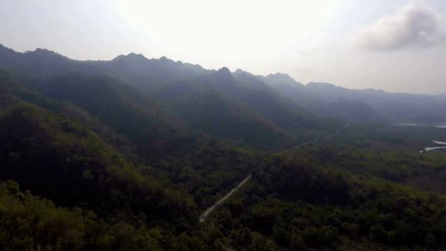 Aerial footage of road along mountain with beautiful sunlight video