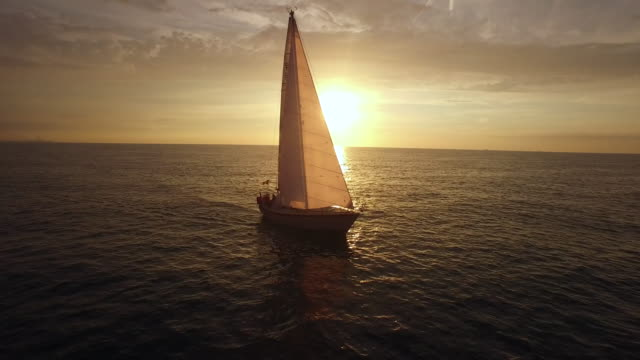 Aerial footage of sailboat during sunset. video