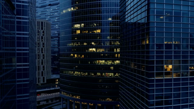 aerial footage of skyscraper at night. 4k. - industria edile video stock e b–roll