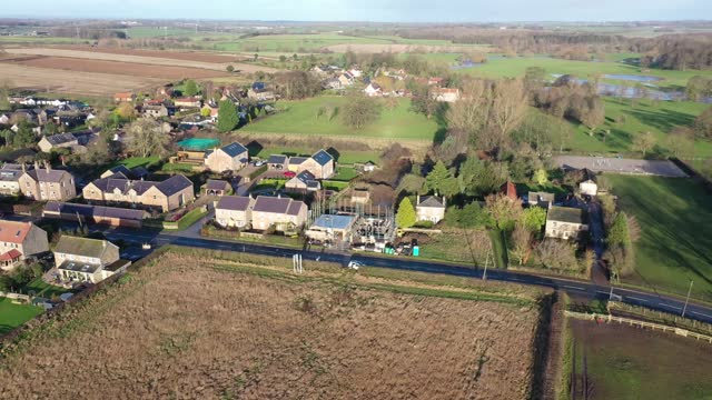 Aerial footage of the British country side fields in the winter time, taken in the town of Wetherby in Yorkshire in the UK