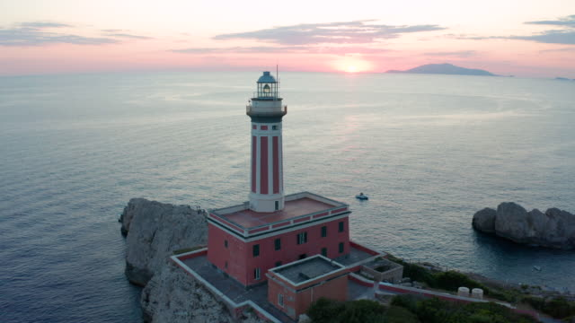 Aerial footage of the lighthouse Faro di punta Carena recorded with drone flying over the island of Capri. 4K.