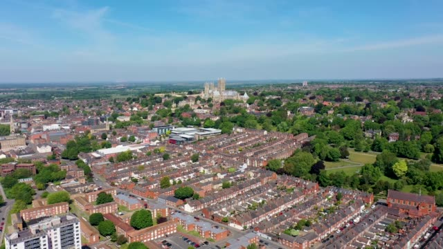 Aerial footage of the Lincoln Cathedral, Lincoln Minster in the UK city centre of Lincoln East Midlands on a bright sunny summers day showing the historic Cathedral Church in the British city centre