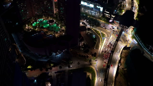 4K Aerial footage of traffic as seen from skyscraper on the jam modern city street. Transportation and public transport concept night video.